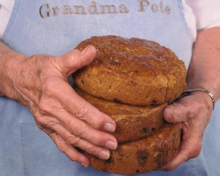 Grandma Pete holding her fruitcake