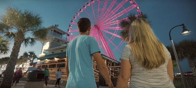 Couple with a pink skywheel