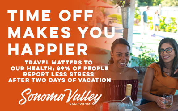 Happy travelers at a table. Sonoma travel makes people happy.