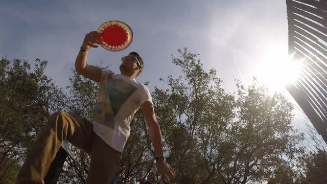 A man in position to throw a disc at Joe Eakes Disc Golf Course in Wilmington, NC