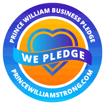 Blue Circle that reads Prince William Business Pledge, in middle blue heart with text over it that reads WE PLEDGE and on bottom of circle says PrinceWilliamStrong.com