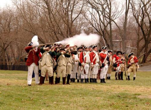 Re-enactors firing muskets during demonstrations