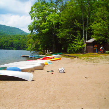 Canoes on beach at Little Pond State Campground