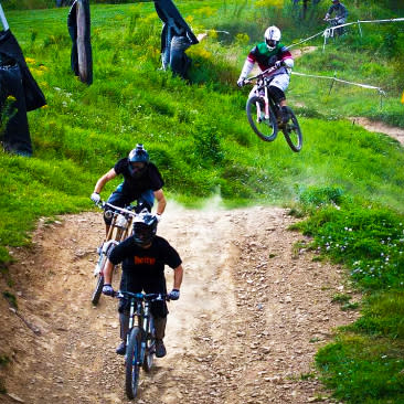 Three bikers riding around Plattekill Bike Park