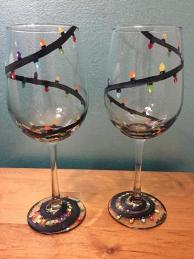 Two glasses decorated with Christmas lights for extra Christmas Spirit