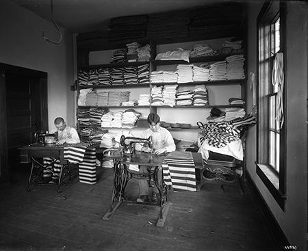 Tailor Shop, U.S. Penitentiary, McNeil Island, photographic print from glass plate negative, circa 1909, by Asahel Curtis.