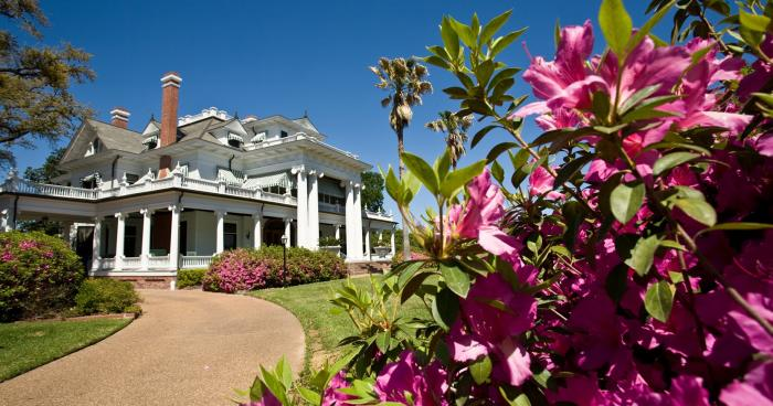 The exterior of the McFaddin-Ward House features beautifully landscaped gardens.