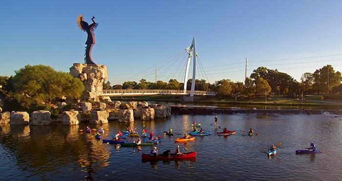 Seasons - kayaks on the Arkansas River in downtown Wichita underneath the keeper of the plains statue