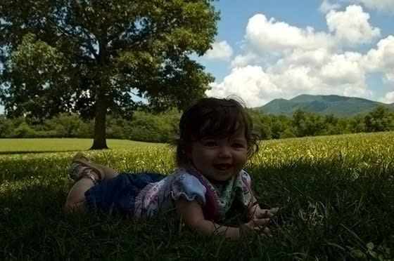 Child Laying in Park Grass