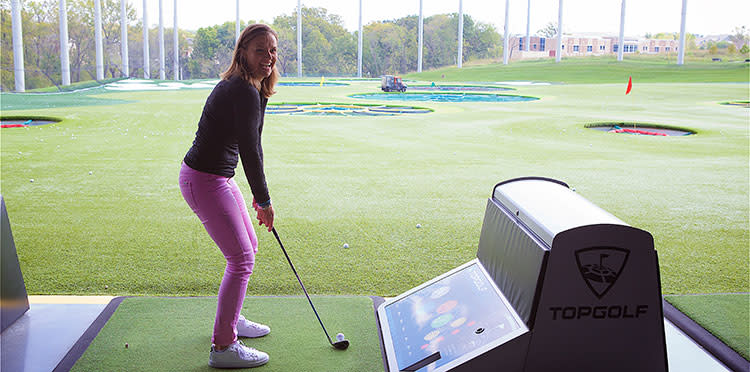 Happy golfer tees up at Topgolf in Overland Park, KS