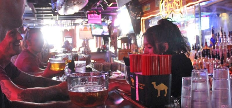Friends ordering drinks at a bar in Park City UT