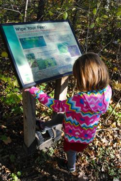Boot brush station as you enter Burnett Woods Nature Preserve in Avon, Indiana.