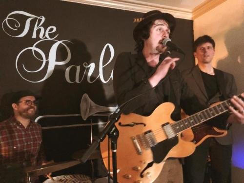 George Barrie band playing live concert inside The Parlor music venue