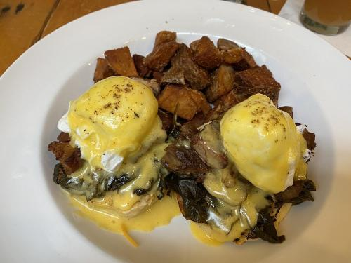 A plated Eggs Benedict dish at Lily's Bistro in Dayton, OH