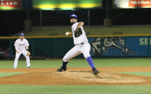 Skeeters pitcher winding up at a Sugar Land Skeeters minor league baseball game.