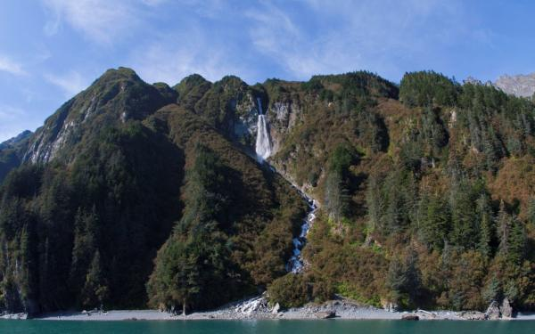 a waterfall on a steep mountain range into Port Valdez