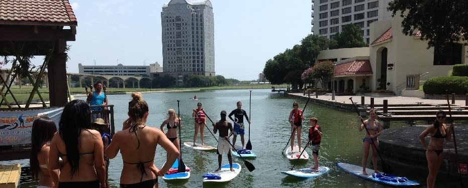 Kids and Adults doing Standup Paddle Board