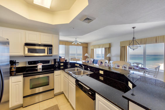 Granite, chrome appliances and fully stocked kitchen