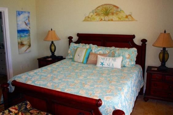 Master bedroom suite with HD Flat screen TV, DVD player and balcony access