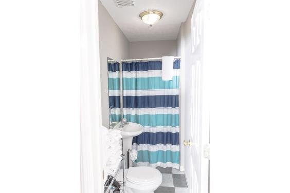 Coastal themed bathroom with shower/tub combo!