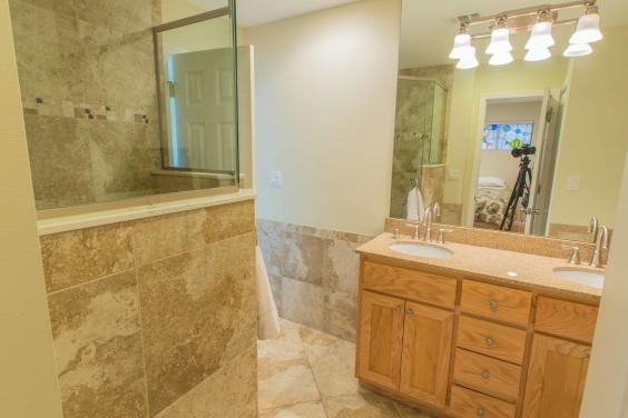 his/hers vanity Granite walk in shower