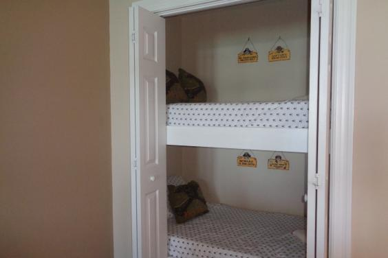 Bunkies (full size twin beds) hidden in an alcove area***children love these