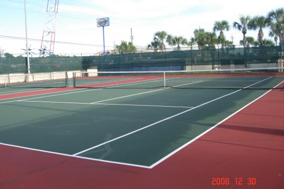 two full size tennis courts with night lighting