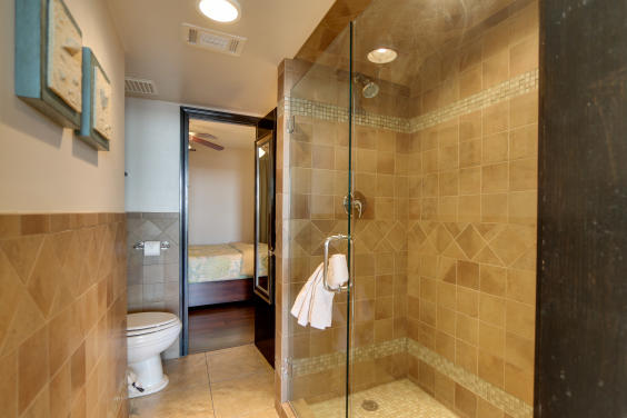 Renovated bathroom with large tiled shower