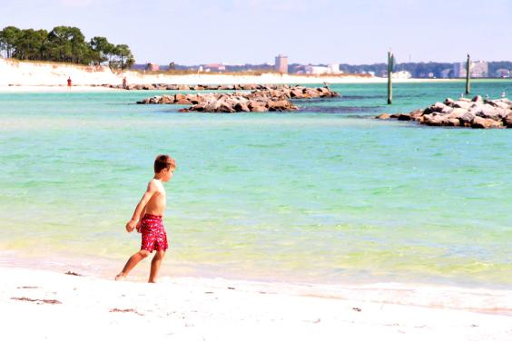 Little Boy Playing at St. Andrews State Park in Panama City Beach Florida