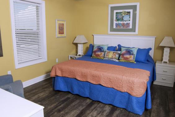 Second floor roadside bedroom has a cozy King bed!
