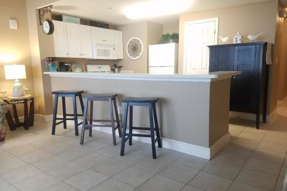 Large Kitchen with bar for extra setting.
