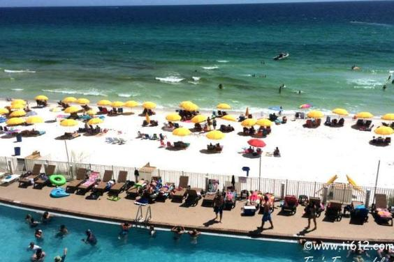 View from our 802 sq ft wrap around balcony of pool and beach