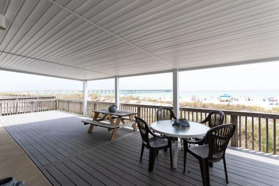 Step out on to the covered deck and take in the salty air!
