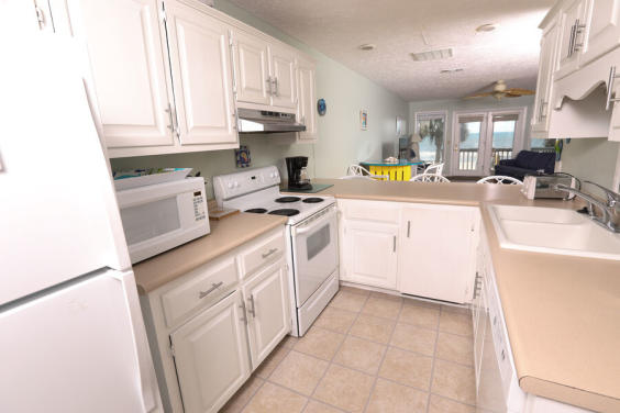 Enjoy cooking in this precious kitchen while still seeing the Gulf!