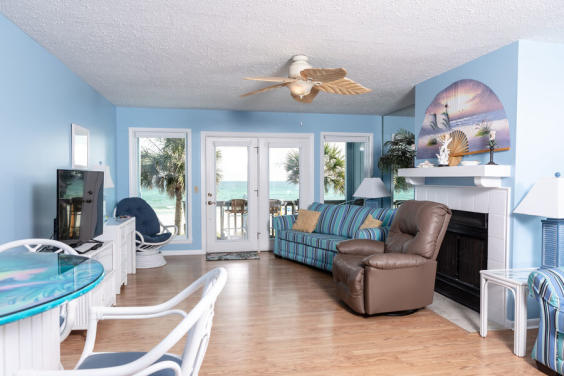 Curl up in this cozy living room and watch the waves!