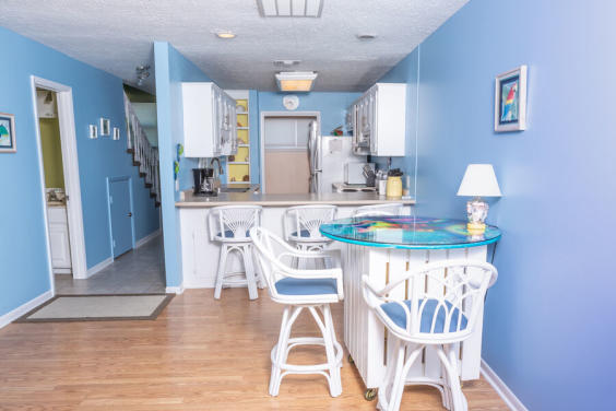 Bright, coastal decor makes this townhome a show stopper!