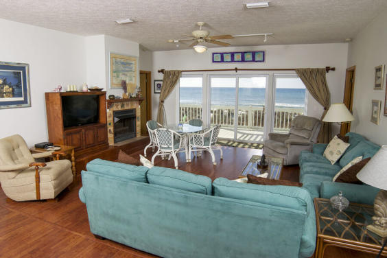 Large, cozy living room is perfect for a movie night while still hearing the waves!