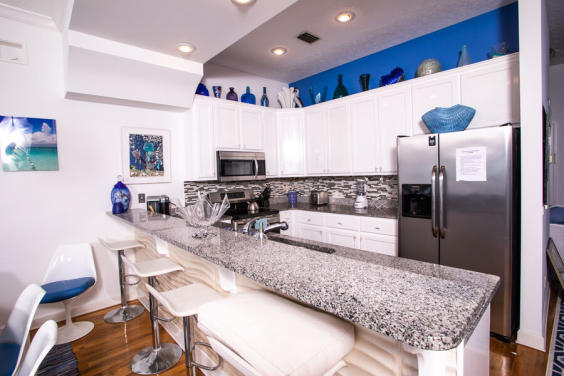 Beautiful, open kitchen allows you to cook and watch the waves at the same time!