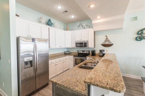 With a fully equipped kitchen, you can enjoy cooking a meal and still seeing the waves!