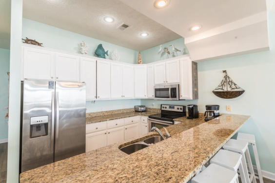 Never lose sight of the beautiful blue waters from this fabulous kitchen!