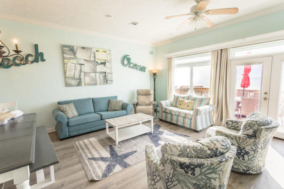 Lovely living room with beautiful views of the Gulf!