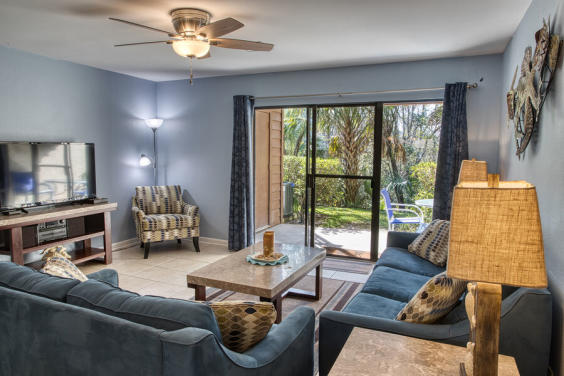 Curl up on the couch and enjoy the beautiful wooded view!