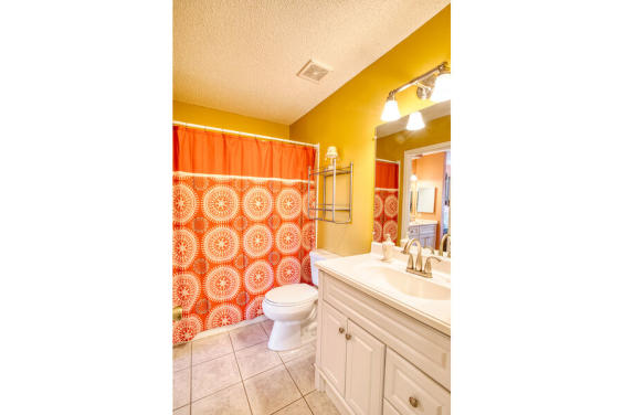 Master Bathroom is bright and colorful with beachy decor!
