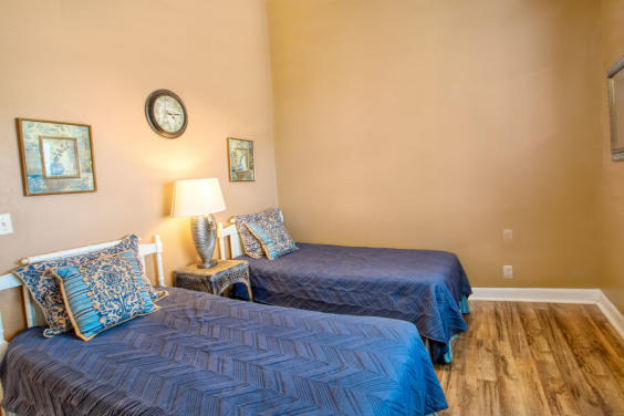 Second bedroom is cozy and bright with two twin beds!