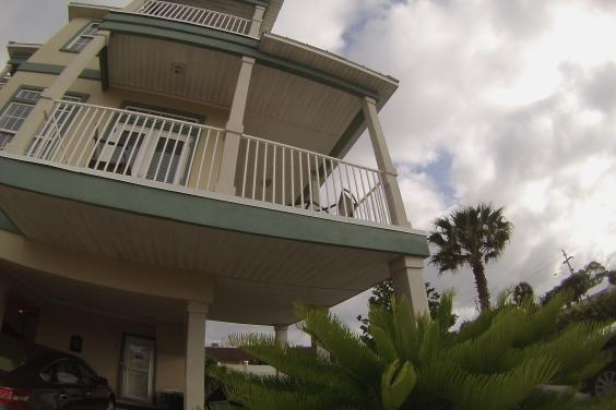 Stunning three story beach house, pet friendly with swimming pool.