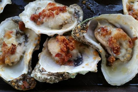 Baked oysters with butter, cheese, and bacon!