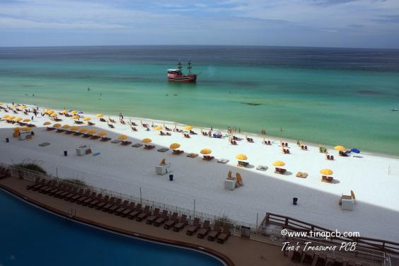 View from our 802 sq ft wrap around balcony of pool and beach as the pirate ship sails by