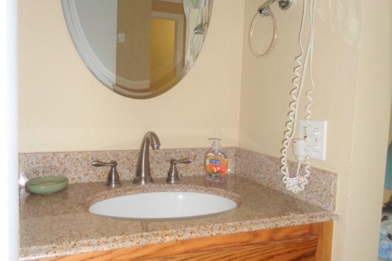 New oak vanity with granite top and hair dryer
