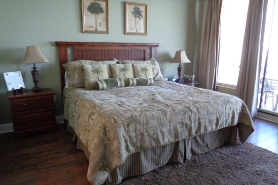 Master bedroom, private bath, flat screen tv, balcony access and full view of the oceanfront
