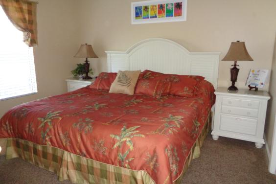 Master bedroom with king bed, tv, master bath with garden tub